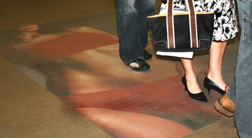 People walking on Hoboken PATH 2005 faceless woman ad